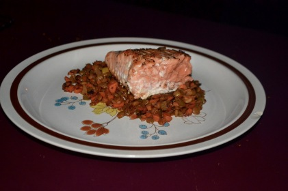 King Salmon over lentils, onions, leeks, carrots, and celery