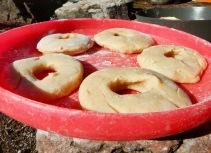raw doughnuts on a frisbee