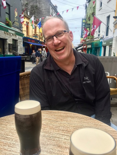 "At an outside table in Galway, just after getting scolded by the barkeep for taking my Guinness before it was ""ready."" It's a two-stage pour in Ireland. I guess I'm a tourist."