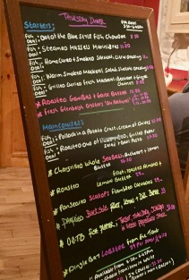 "The menu board at ""Out of the Blue,"" a seafood restaurant in Dingle"