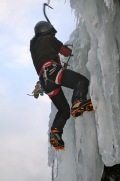 Pulling an overhang at Right of Pitchoff, Cascade Pass