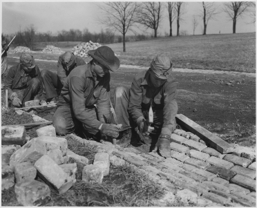CCC laying stone for a road, 1933. Photo courtesy of National Archives, public domain